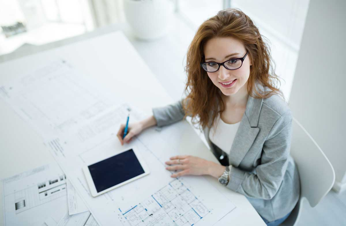 beautiful-female-architect-working-on-plan-7TDSK3B