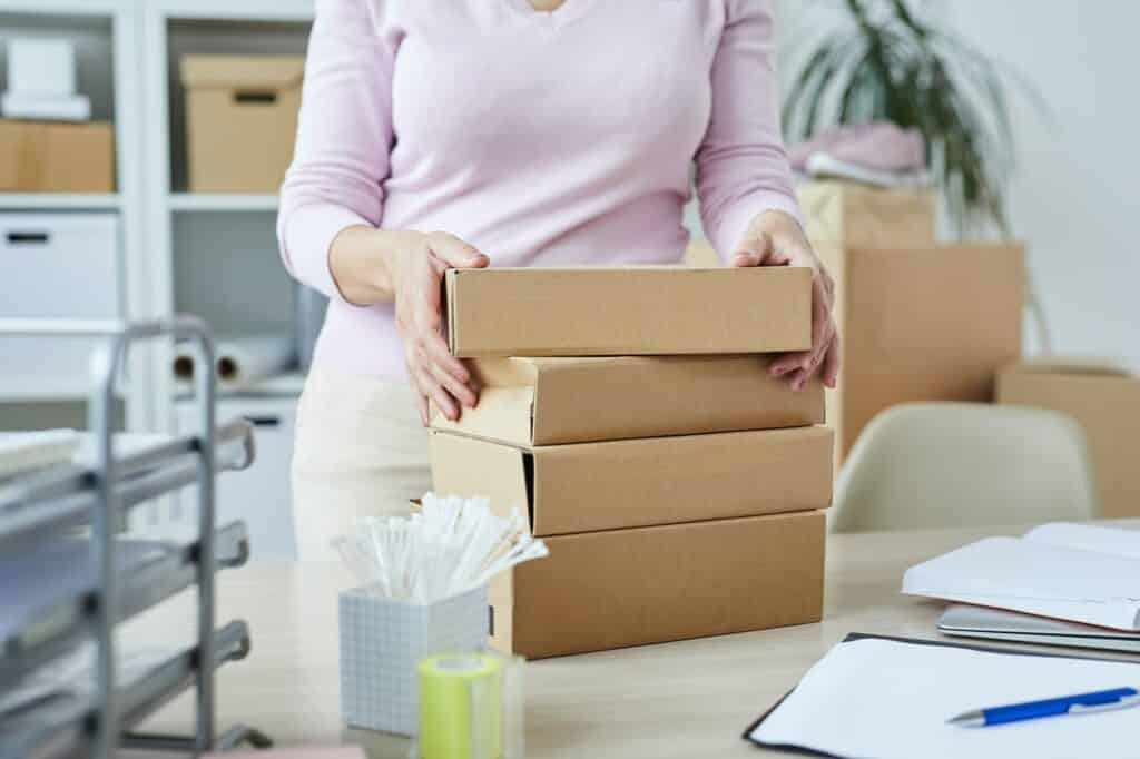 Stack of packed boxes with orders of online shop clients